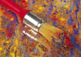 Paint Brush with color applied to canvas